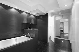 white frame mirror white marble floor tile with black accent dark plain white t shirts plain white tees