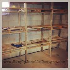 how to make shelves out of wood pallet shelves in our basement simply janelle designs projects