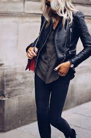 lucy connelly s leather jacket has been matched with a simple silky on down shirt