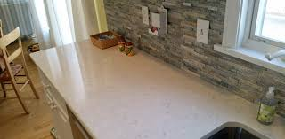 granite countertop tiled backsplash