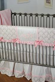 monogrammed crib bedding white and pink silk with the monogram in thread on baby