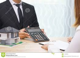 Businessman Showing The Home Price On Calculator And