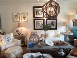 coastal driftwood orb chandelier in beach house decor