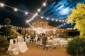 rustic barn wedding reception lighting in scottsdale phoenix arizona are with elegant string lighting and twinkle barn wedding lighting