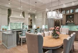 traditional kitchen with raised island breakfast bar and open concept design to dining table