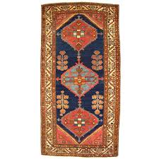 antique persian hamadan oriental rug in small runner size with minimal design for