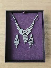 art deco style necklace and earrings
