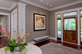 beige grasscloth wallcovering with tropical wallpaper entry transitional and glass front door