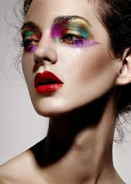 dramatic colourful makeup with a bold red lip