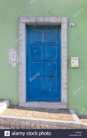 Turquoise front door Blue Doors Turquoise Front Door On Green Colored Exterior Wall Alamy Turquoise Front Door On Green Colored Exterior Wall Stock Photo