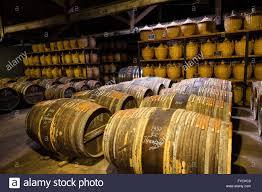 storage oak wine barrels. Hennessy Ageing Warehouse Where The Eaux-de-vie Is Stored In Oak Barrels To Mature Before Blending, Cognac, Poitou-Charente Storage Wine B