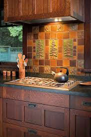 in an arts crafts revival kitchen an artistic tile panel by handcraft tile co