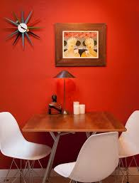 view in gallery eccentric dining space proudly showcases the george nelson sunburst clock