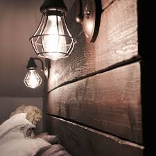 a rustic diy headboard with lamps