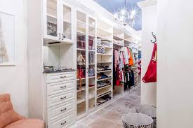 bedroom closet with drawers and shelving walk in narrow closet