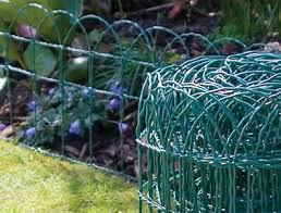 wire garden fence. A Long Roll Of Green Plastic Coated Decorative Wire Border Fence Encloses  Plants In Garden ,