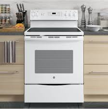 white electric range. Beautiful White Stainless Downdraft Electric Range With Smooth Wooden Cabinet Under Gray Countertop Plus Black Ceramic