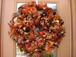 Dazzling Glass Thanksgiving Door Idea Featuring Light Brown Door Frame And  Brown Orange Ribbon Wreath And Gold Pearls Together With Gold Ribbon  Accents.
