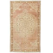 vintage pale pink turkish oushak rug for