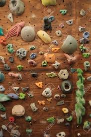 stock photo vertical image of homemade indoor artificial climbing wall covered with colored holds for rock climbing training on rock climbing artificial wall with vertical image of homemade indoor artificial climbing wall covered