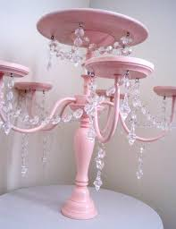 subsequent use the additional gold and silver tinsel from the chandelier and minimize the additional items into this can act as platform to position trays