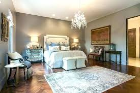 rug on carpet bedroom rugs on carpet traditional master bedroom with chandelier vintage grey area rug rug on carpet