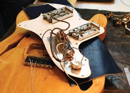 how to install a replacement pickup opening the cover of the reissue tele reveals the underside of the modern fender humbuckers notice how the guitar is protected by a leather pad