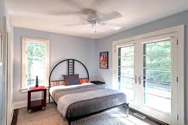 light grey walls bedroom light grey walls white trim bedroom contemporary with french doors striped pillow