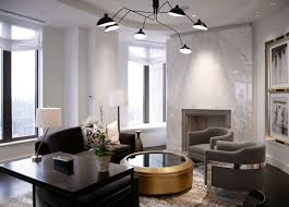 view in gallery glamorous living room with a white marble fireplace