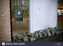 The Apple store sandbags their doors as protection against flooding ...