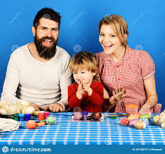 Family Prepares Colored Eggs As Easter Decorations Stock Image