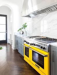 gray kitchen cabinets with yellow stove