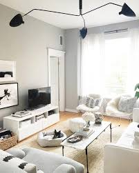 the stylish angles of modern furniture and lighting pieces are best cast against the backdrop of gray walls trimmed with white