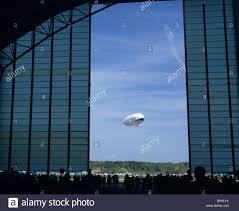 Viewed from his hangar doors, the modern airship dirigible ...