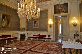 this is a unique salon in the palace its green wallpaper combined with its paintings and chandeliers gives it a true sense of elegance