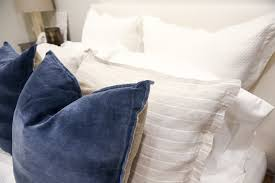 at the foot of the bed i used a big fur blanket it s this one to make the bed look extra cozy a lot of these fur blankets on the market are