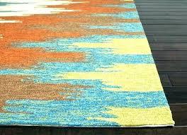 s orange yellow green area rug and