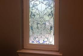 beveled ribbon fl window insulated and installed in a vinyl frame