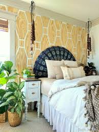 boho master bedroom with plywood geometric accent wall reality daydream