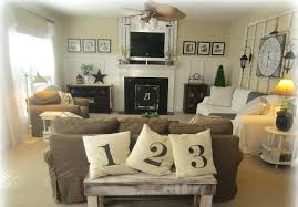 traditional living room ideas with fireplace and brown linen long sofa white covers wall decor kitchen uk l
