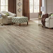 long view pine s blend of light toned rustic grays and browns gives this vinyl floor the appearance of aged barn wood eagle creek syncorex wind oak