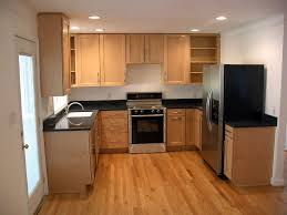U Shaped Kitchen Layout Four Wooden Dining Chair On The Black U Shaped White Kitchen