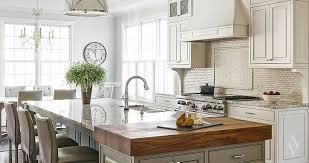 cream tumbled marble kitchen backsplash