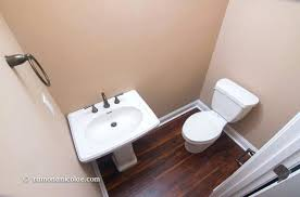 laminate flooring in bathroom toilet can i install laminate under a bathroom toilet and sink throughout laminate flooring in bathroom toilet