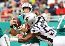 new england patriots linebacker dont a hightower sacks miami dolphins quarterback ryan tannehill during an