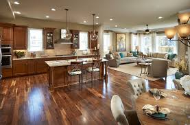 Gleaming Wood Flooring Ties The Space Together  6 Great Reasons Open Floor Plan Townhouse