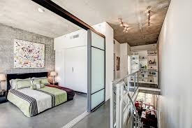 baroque vera bedding in bedroom with loft partitions next to sliding wall alongside ikea sliding doors