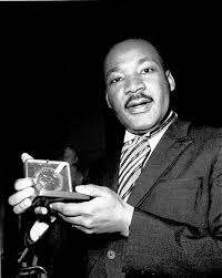 images martin luther king jr  martin luther king jr displays his 1964 nobel peace prize medal in
