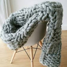 this chunky arm knitted blanket is one of our favorite diy inspired gifts