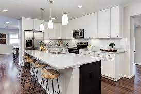 contemporary kitchen with white cabinets carrara white countertopatching subway tile backsplash